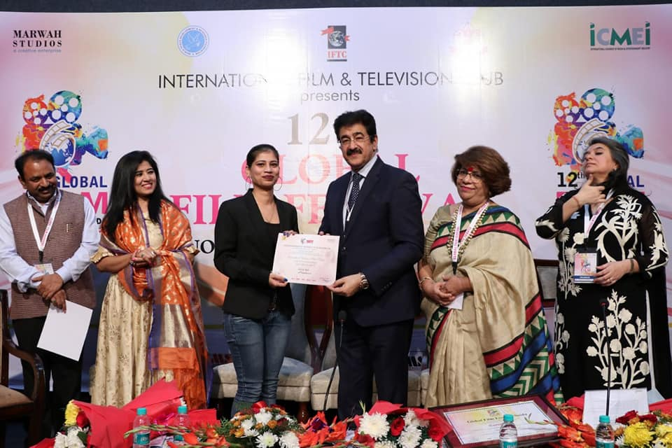 Fashion Designer Sukriti Ralli Receives Certificate From Sandeep Marwah of the Marwah Studio Fame
