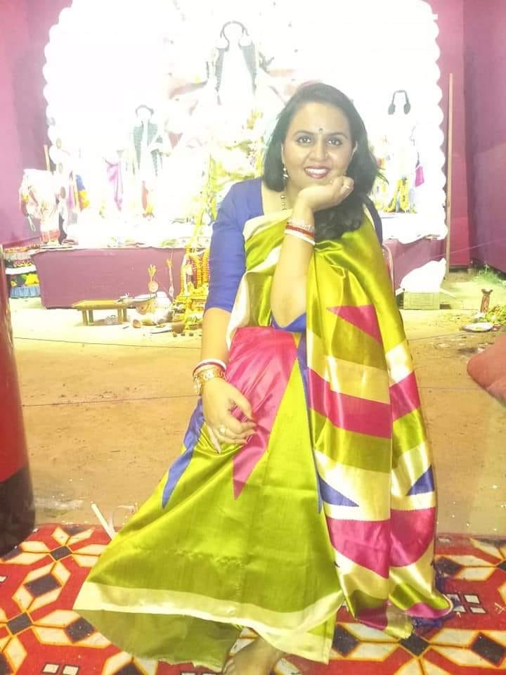 Women in Red and Green Saree During Durga Puja